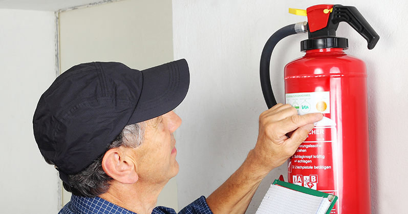 Dire extinguisher maintenance - checking fire extinguisher