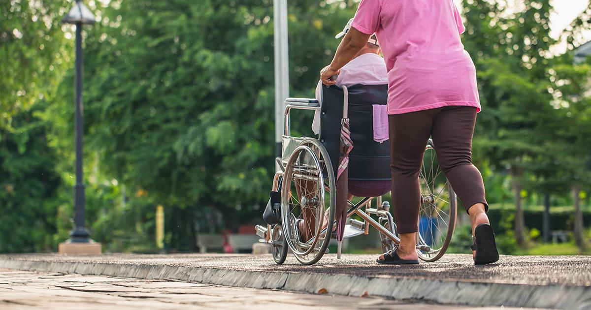 Man in wheelchair outside.
